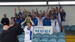 Captain Tom Kavanagh lifts the Westaro Cup at Milebush on Sunday.